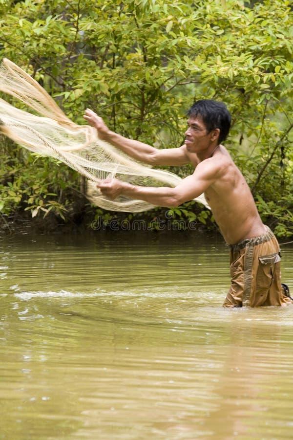 De visserij met werpt netto stock foto's