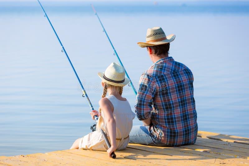 De visserij van de vader en van de dochter royalty-vrije stock afbeelding