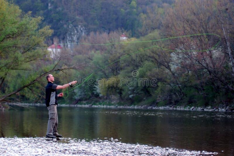 De visserij van de vlieg stock foto's