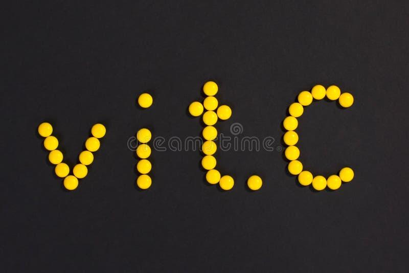 De Vitamine C van de pilleninschrijving royalty-vrije stock afbeeldingen
