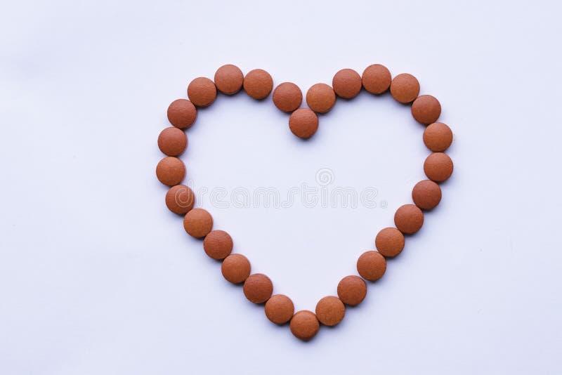 De vitaminegeneeskunde neemt de ziekte dally rode pillen van het gezondheidsrisico stock afbeelding