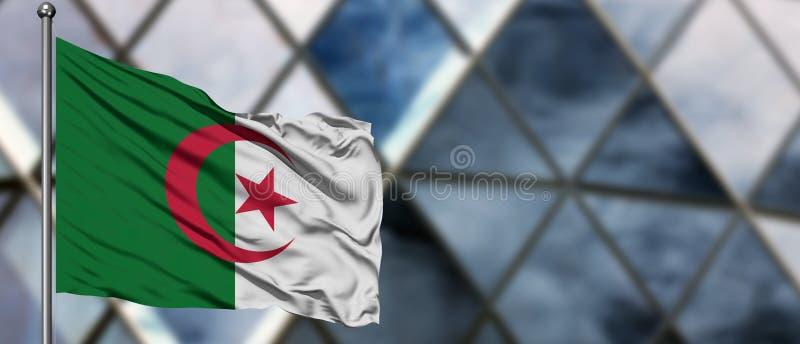 De vlag die van Algerije in de wind tegen de vage moderne bouw golft Bedrijfs concept Nationaal samenwerkingsthema royalty-vrije stock afbeelding