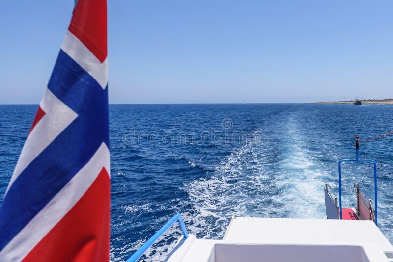 De vlag en de mening van Noorwegen van een bootstaart stock afbeeldingen