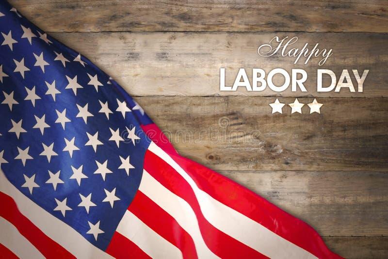 De vlag van Amerika met tekst van Gelukkige Dag van de Arbeid op lijst stock foto