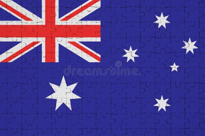 De vlag van Australië wordt afgeschilderd op een gevouwen raadsel stock afbeelding