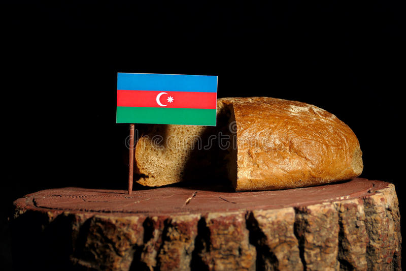 De vlag van Azerbeidzjan op een stomp met brood royalty-vrije stock afbeelding