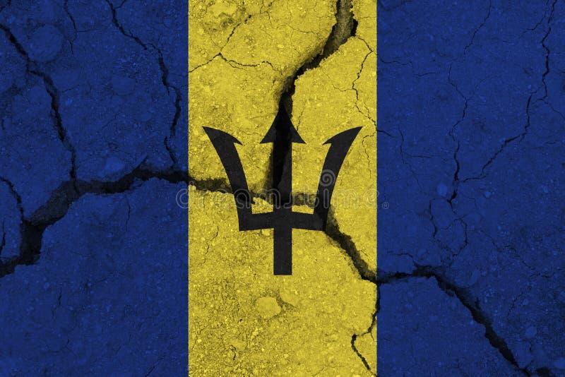 De vlag van Barbados op de gebarsten aarde royalty-vrije stock fotografie