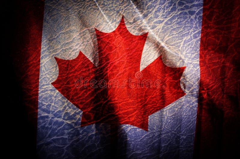 De vlag van Canada, Grunge gefiltreerde achtergrond stock foto's