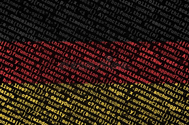 De vlag van Duitsland wordt afgeschilderd op het scherm met de programmacode Het concept moderne technologie en plaatsontwikkelin royalty-vrije stock foto's