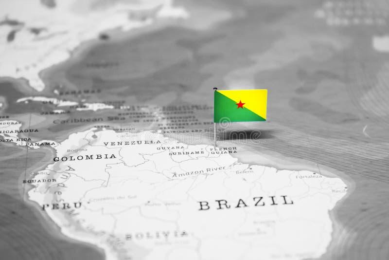 De Vlag van Guyana in de Wereldkaart stock foto