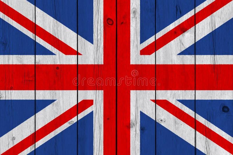De vlag van het Verenigd Koninkrijk die op oude houten plank wordt geschilderd stock foto's