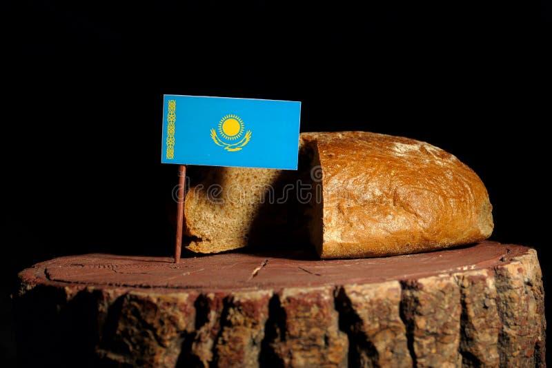 De vlag van Kazachstan op een stomp met brood royalty-vrije stock foto