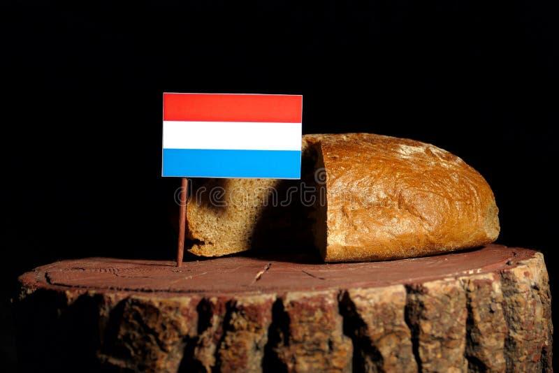 De vlag van Luxemburg op een stomp met brood royalty-vrije stock foto