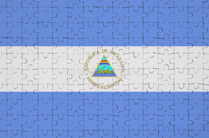 De vlag van Nicaragua wordt afgeschilderd op een gevouwen raadsel royalty-vrije stock foto