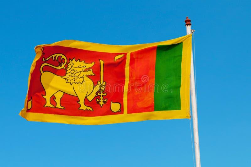 De vlag van Sri Lanka op vlaggemast. royalty-vrije stock fotografie