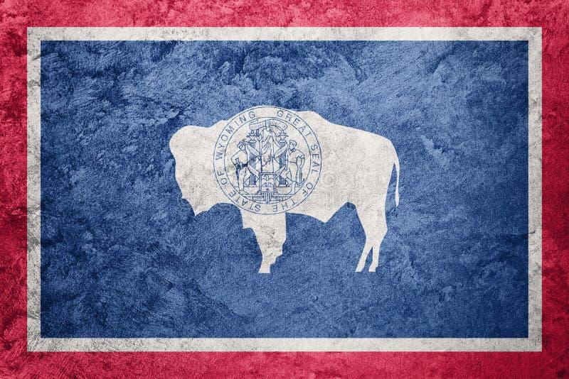 De vlag van de staat van Grungewyoming De vlagachtergrond van Wyoming grunge textur stock illustratie