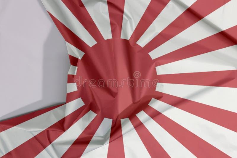 De vlag van de stoffenoorlog van het Keizer Japanse Leger omfloerst en vouwt met spaties stock afbeeldingen