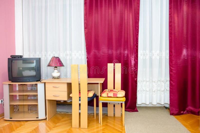 De vlekhoek van Nice van slaapkamer met lijst royalty-vrije stock afbeelding