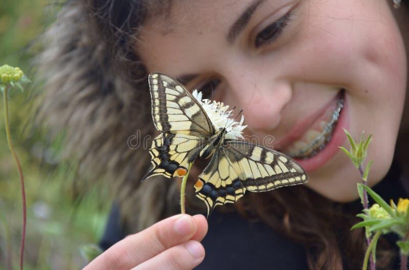 De vlinder maakt me glimlach stock foto's