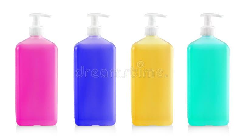 De Vloeibare gekleurde containers voor gel, lotion, room, shampoo, bad van roze kosmetische plastic fles met witte automaatpomp royalty-vrije stock afbeeldingen