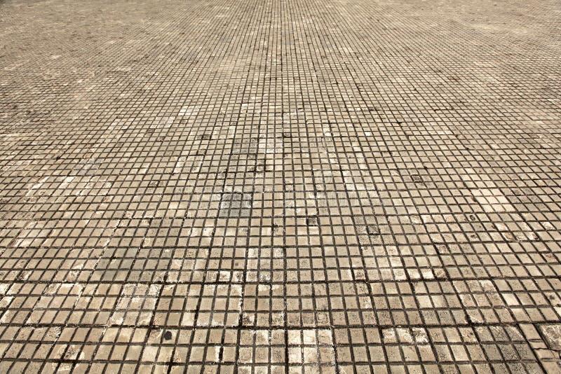 De vloer van de tegel die van steen, vuile wit en oud wordt gemaakt royalty-vrije stock afbeelding
