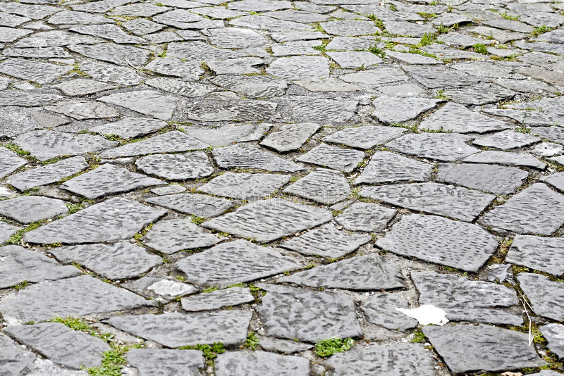 De vloer van het steenblok van bestrating op stadsstraat stock foto's