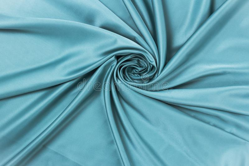 De vlotte elegante zijde of satijntextuur van de luxedoek kan als abstracte achtergrond gebruiken stock foto