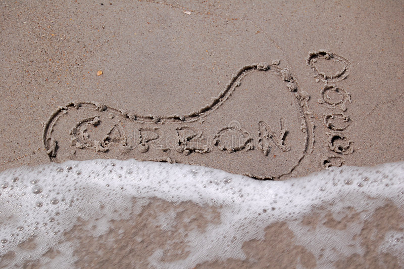De Voetafdruk van de koolstof in het Zand stock afbeeldingen