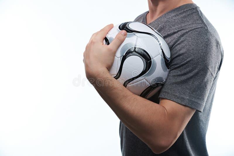 De voetbalbal van de mensenholding royalty-vrije stock foto