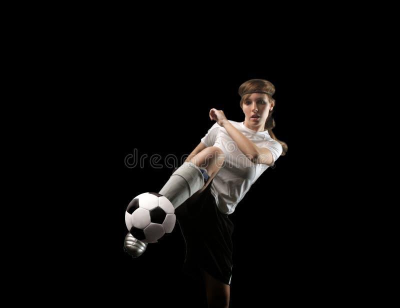 De voetballer van het meisje stock afbeelding