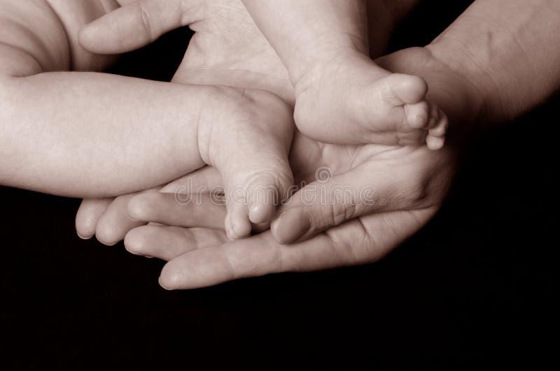 De voeten van de baby `s stock afbeelding