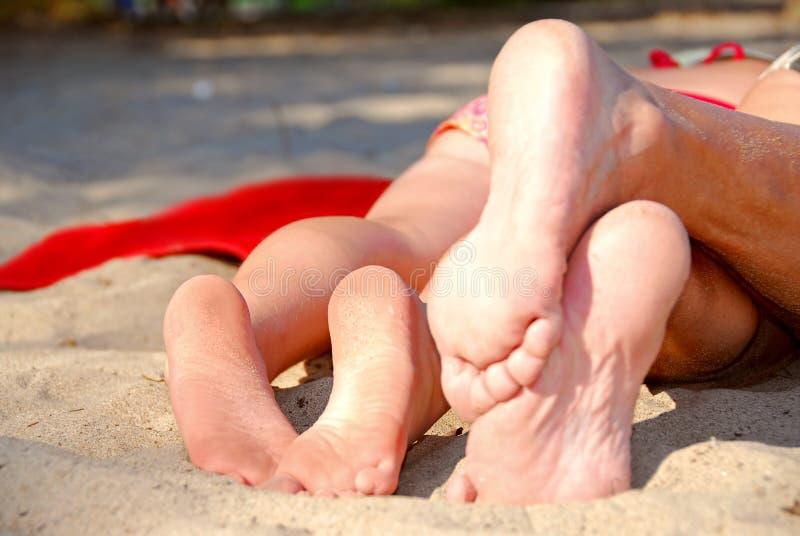 De voeten van het strand stock fotografie