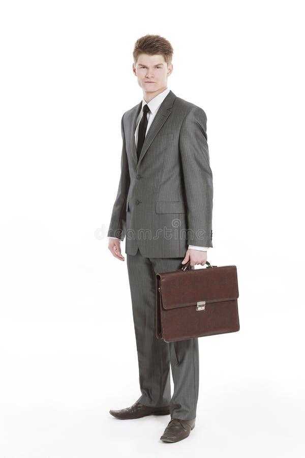 In de volledige groei Jonge zakenman met een leeraktentas stock fotografie