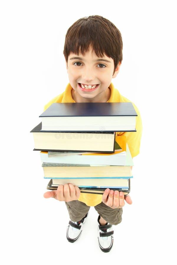 De volta à criança do menino de escola com livros de texto fotos de stock