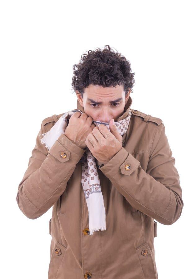 De volwassen mens in de laag behandelt het gezicht met sjaal royalty-vrije stock afbeelding