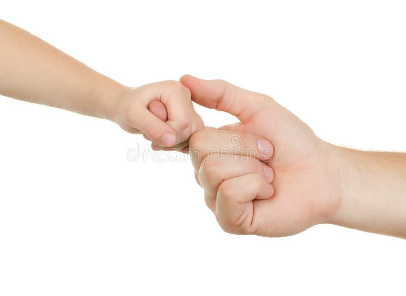 De volwassene en het kind van de hand stock afbeelding