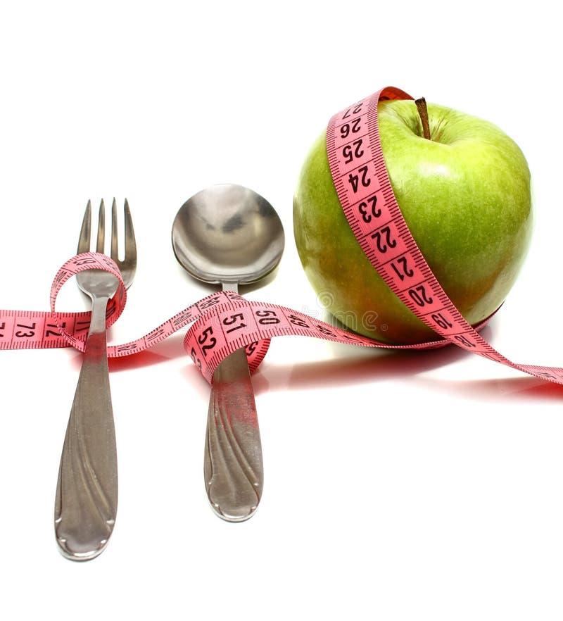 De vork en de appel van de lepel royalty-vrije stock foto