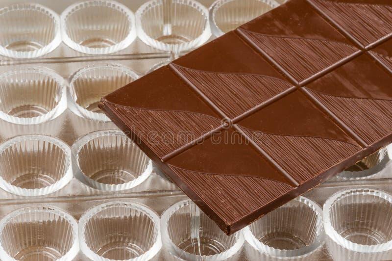 De vorm van de chocoladepraline stock afbeelding