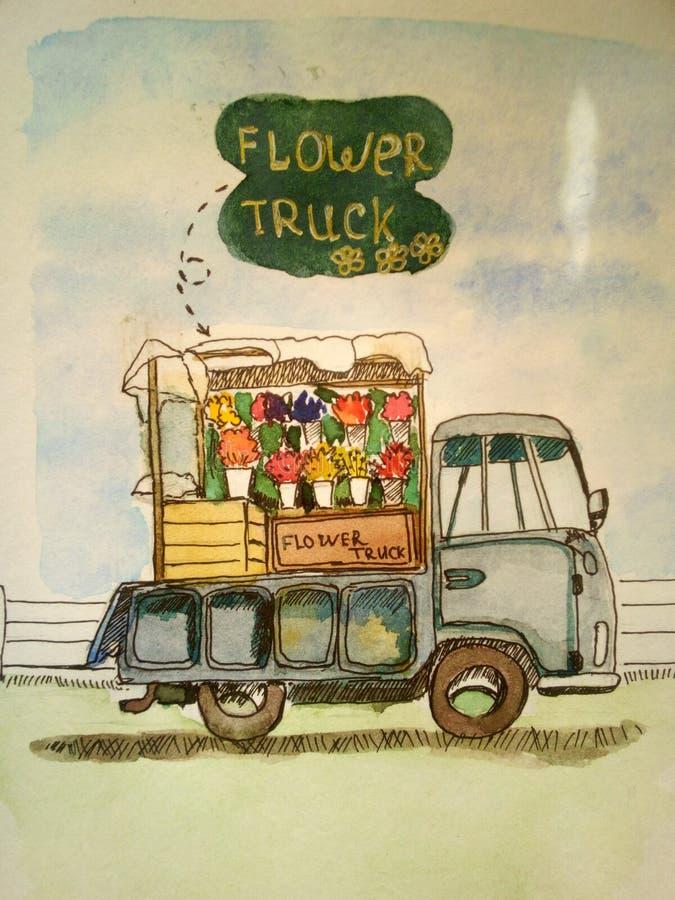 De vrachtwagen met bloemen wacht op zijn klanten stock foto