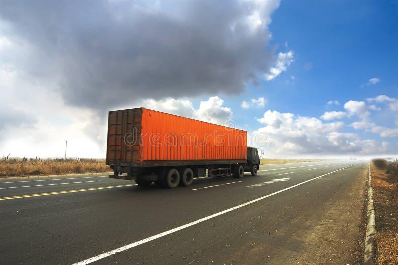 De vrachtwagen van de container stock afbeelding