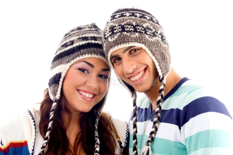 De vrienden die van tienerjaren en camera glimlachen bekijken royalty-vrije stock afbeelding