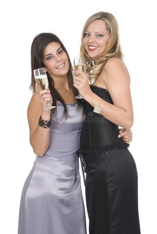 De vrienden van Elegants bij het nieuwe jaarpartij lachen royalty-vrije stock afbeeldingen