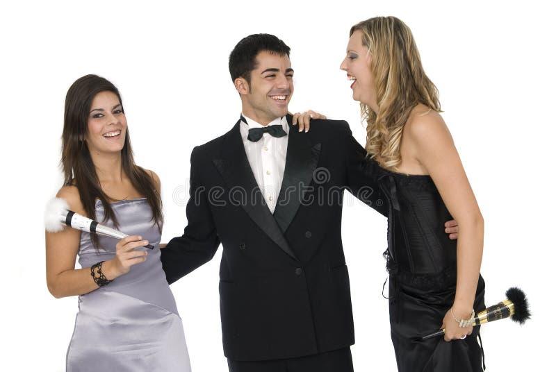De vrienden van Elegants bij het nieuwe jaarpartij lachen stock fotografie