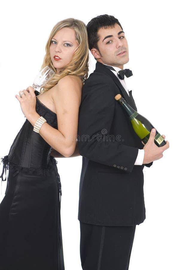 De vrienden van Elegants bij het nieuwe jaarpartij lachen stock foto