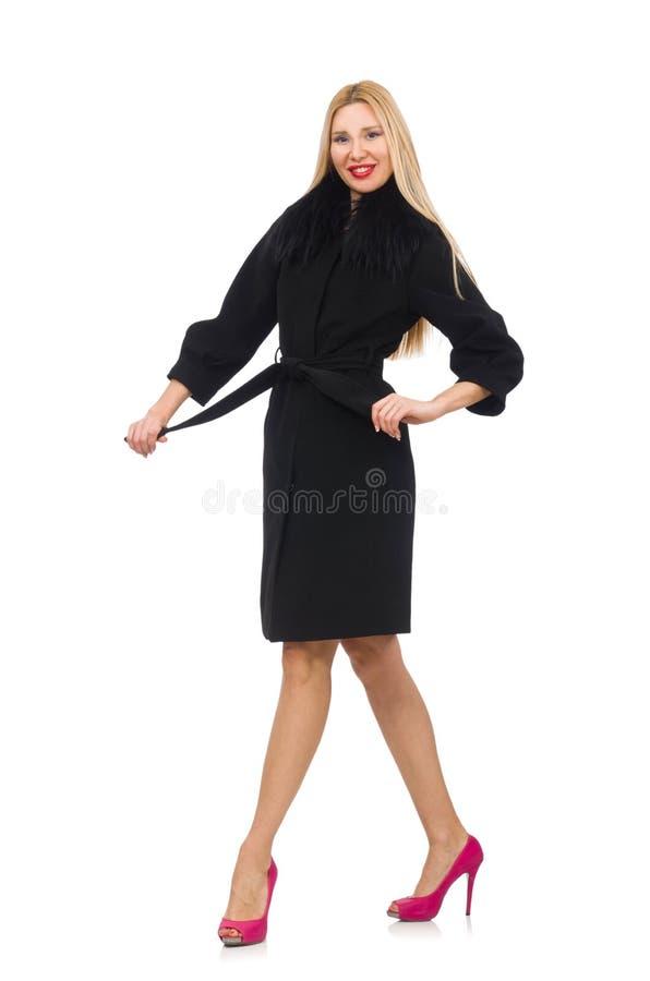 De vrij blonde vrouw in zwarte die laag op wit wordt geïsoleerd royalty-vrije stock afbeelding
