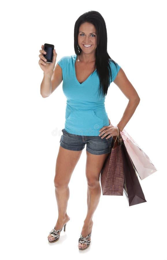 De vrij Jonge Slimme Telefoon van de Holding van de Vrouw royalty-vrije stock afbeeldingen