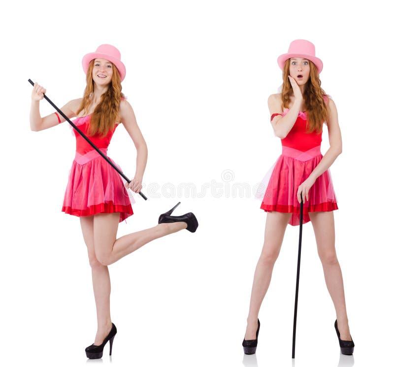 De vrij jonge tovenaar in mini roze die kleding op wit wordt geïsoleerd royalty-vrije stock foto