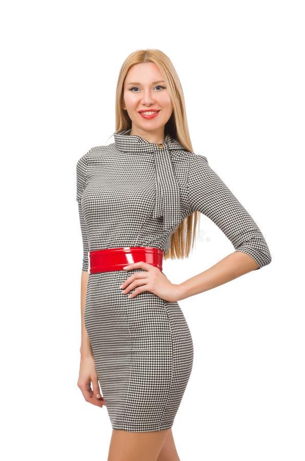 De vrij jonge vrouw in grijze kleding op wit royalty-vrije stock afbeelding