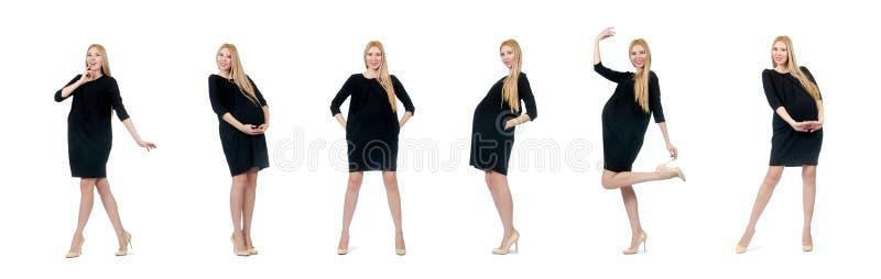 De vrij zwangere vrouw in mini zwarte die kleding op wit wordt geïsoleerd stock foto's