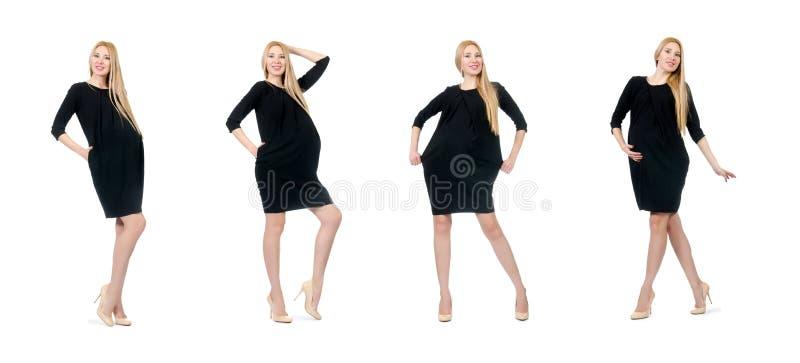 De vrij zwangere vrouw in mini zwarte die kleding op wit wordt geïsoleerd royalty-vrije stock foto's